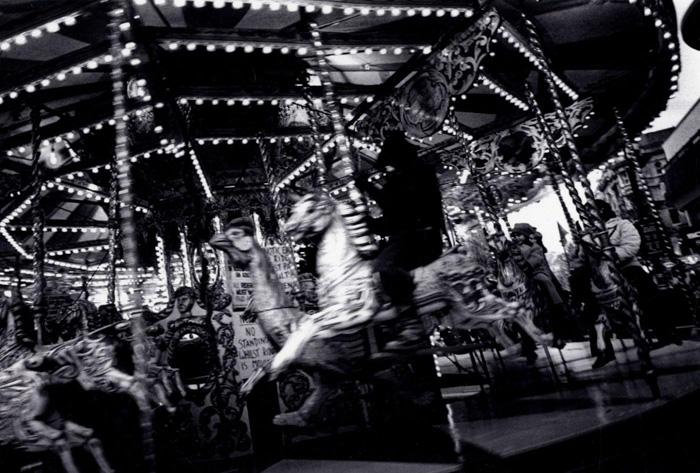 A black and white photo of a carousel by Daidō Moriyama