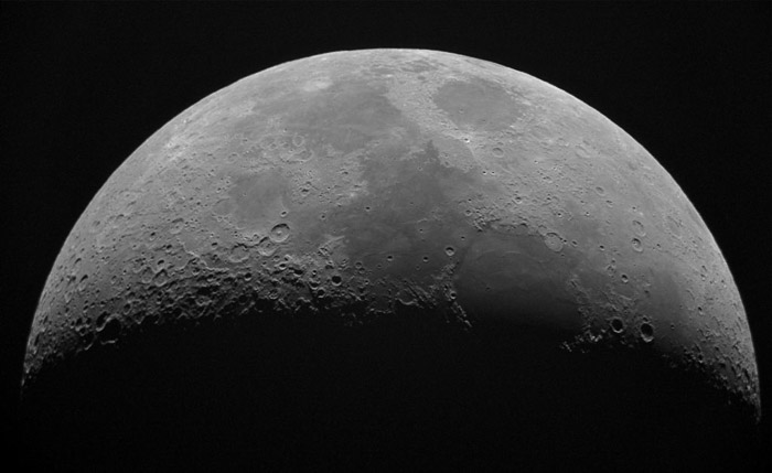 A close up photo of the moon shot with a telephoto lens