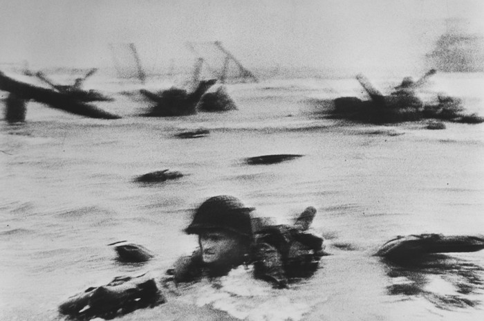 The d-day beach landings as photographed by Robert Capa, famous war photographers