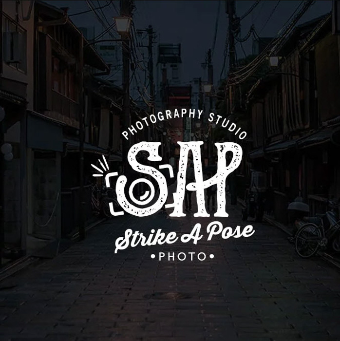 The Strike A Pose photography logo for a photography studio