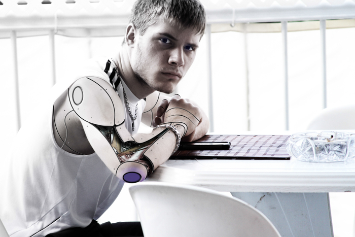 A portrait of a male model with a robotic arm - types of stock photos to avoid