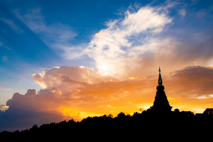 The silhouette of a pagoda against a stunning sunset