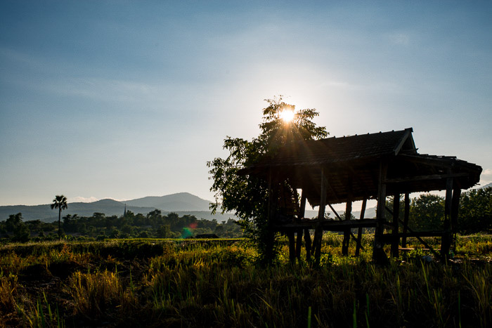 The silhouette of a rice shack at evening time - what is backlighting in photography