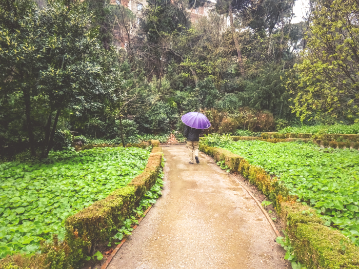 A person walking through Parc del Laberint d'Horta in Barcelona