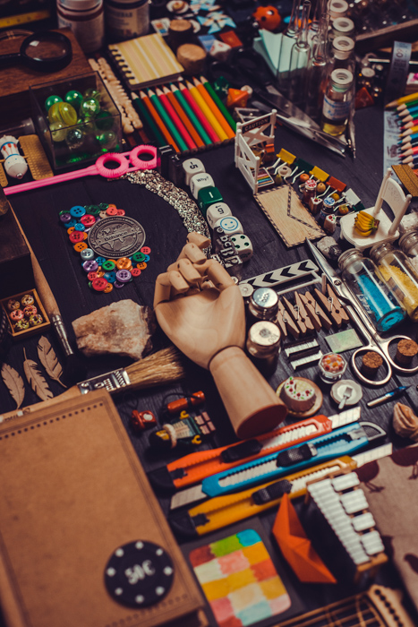 Materials for making a creative flat lay - colored pencils, sketchbooks, brushes, paints, fabrics for patchwork and stamps for scrapbooking