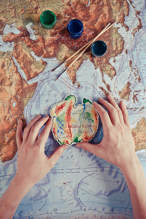A creative image of a person painting a map of a world - examples of using text in photography