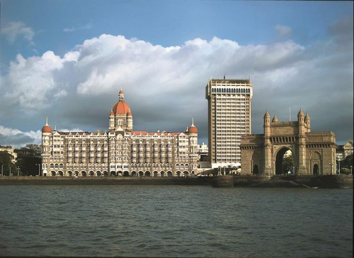 A viw of impressive buildings from across a river - architecture photography copyright