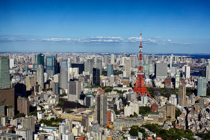 The iconic Tokyo Tower among a sprawling cityscape - best photography location in Tokyo