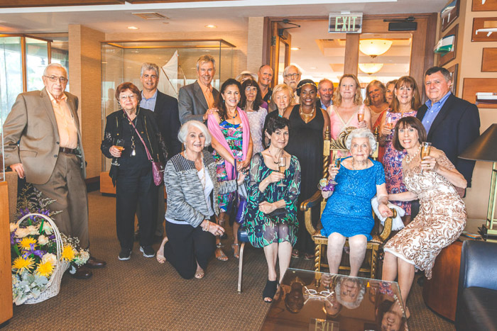 A large group shot of family members at a birthday photography