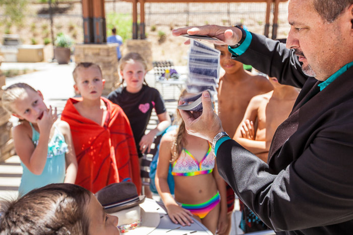 A magician performing at a kids birthday party - how to take good party pictures