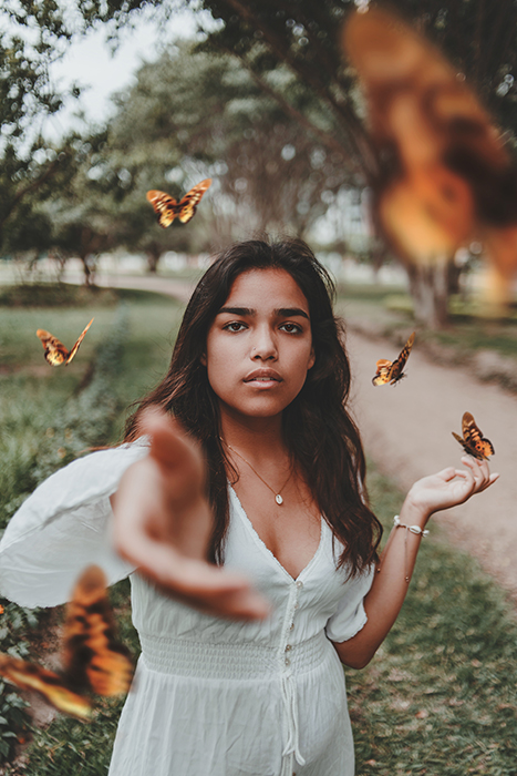 A conceptual photography portrait using Butterflies to symbolise freedom and Creativity