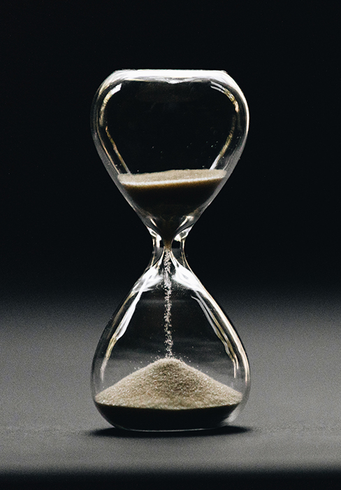 Atmospheric photo of an hourglass - conceptual photo ideas