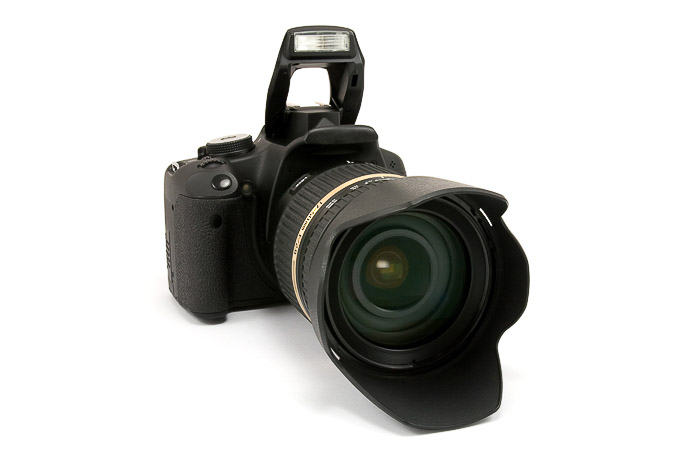 A DLSR camera on white background - parts of a camera