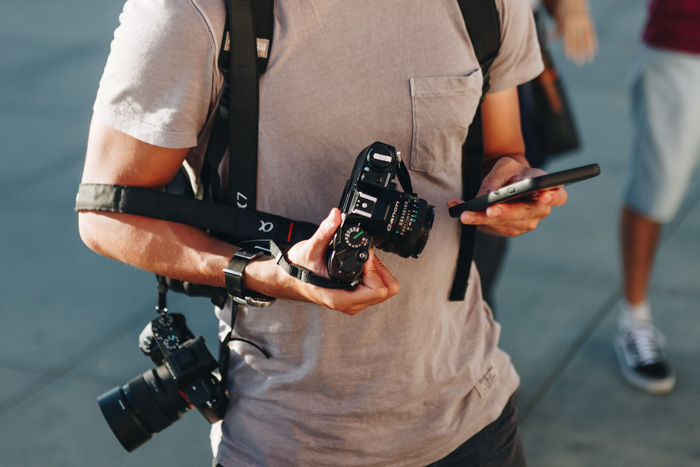 street photographer holding a 35mm film camera