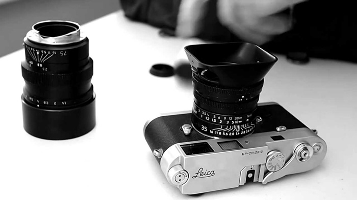 The Leica MP beside a camera lens