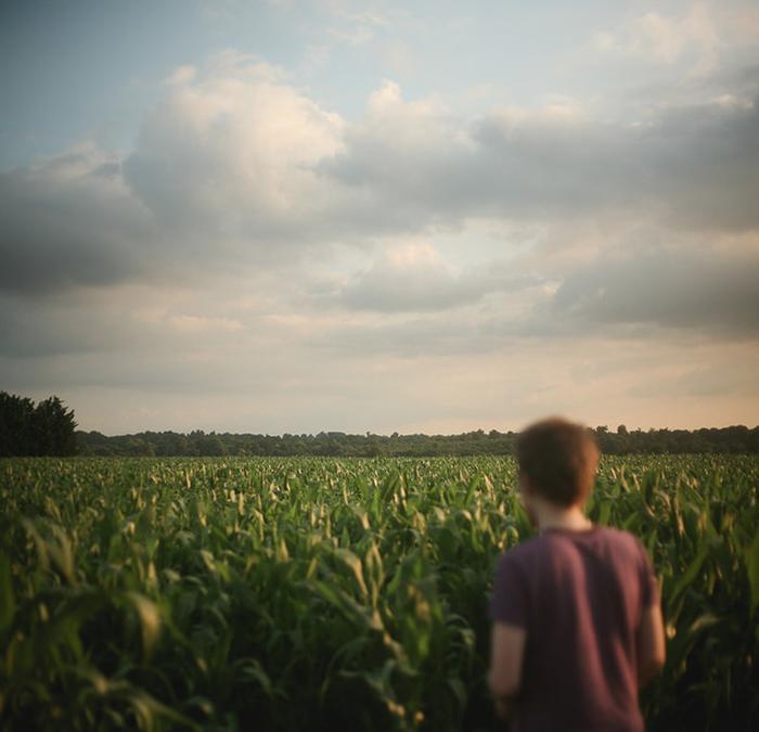 Mysterious fine art portrait of a man in a field