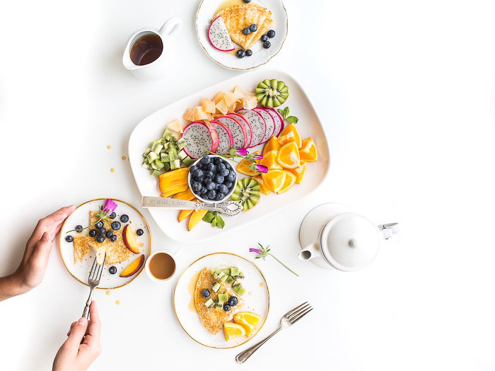 A bright and airy food flat lay of plates of fruit salad - - food photography examples