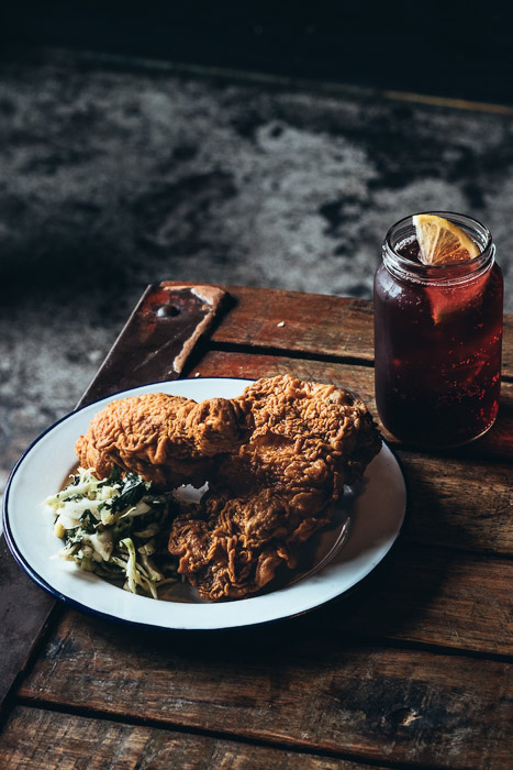 A rustic shot of breaded meat on a wooden board - food photography examples