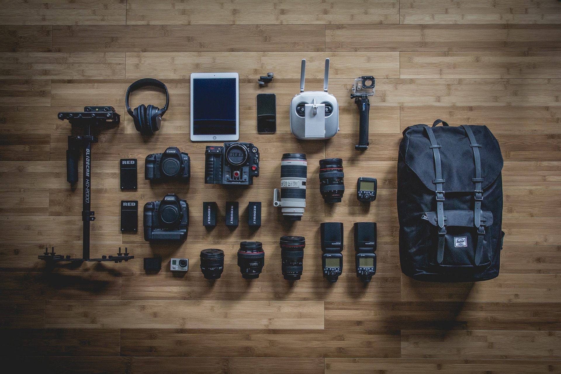 Journalism equipment laid out on a wooden table