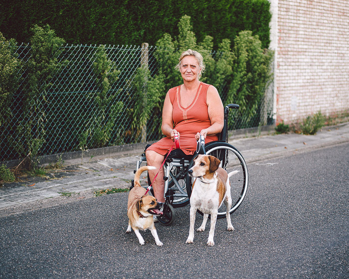 A portrait of a woman in a wheelchair outdoors