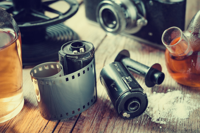 A close up of film rolls and other camera equipment - developing film at home