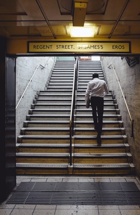 A ,man walking upstairs at Regent st, st. james tube station in london - photo file types and extensions