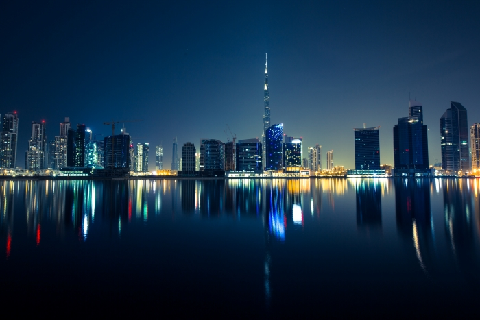 reflection of a city skyline at night