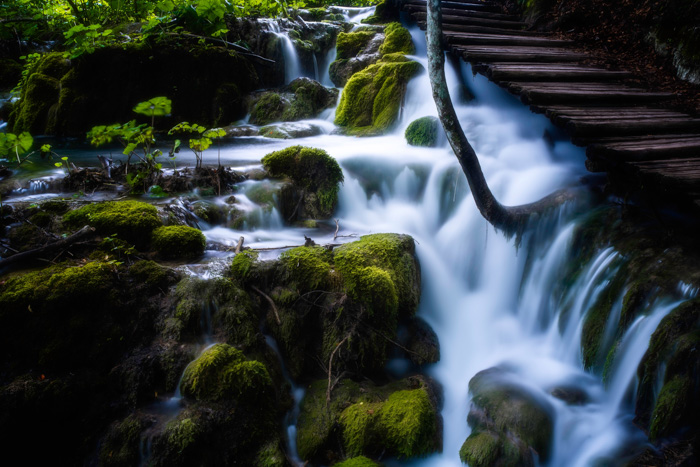 A luscious landscape scene of a flowing water, edited using the orton effect