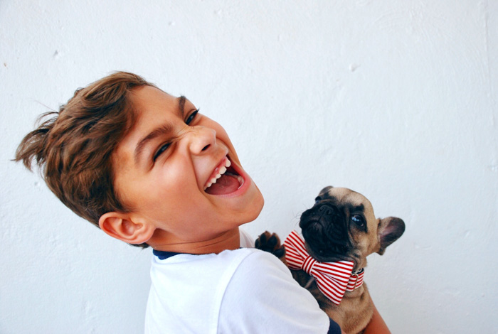 Sweet pet portrait of a little boy holding a small dog wearing a bowtie by Alicia Jones - pet photography ideas