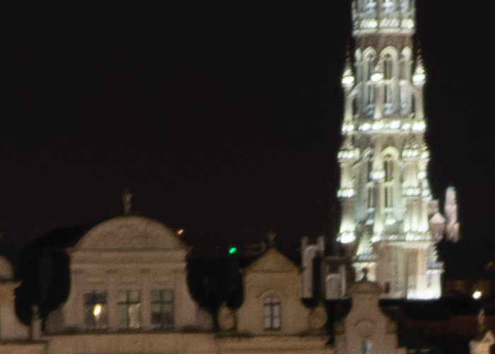 An architecture photographed at night, blurry due to camera motion blur