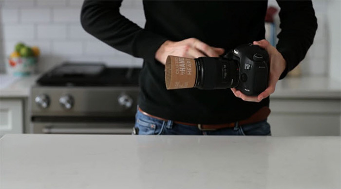 A photographer using a coffee hood as a lens hood - diy camera hacks