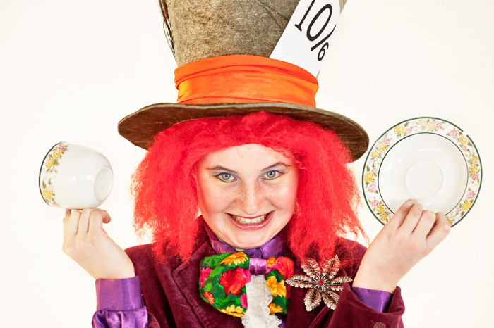 A humorous portrait of a woman dressed up as the mad hatter - photoshoot ideas