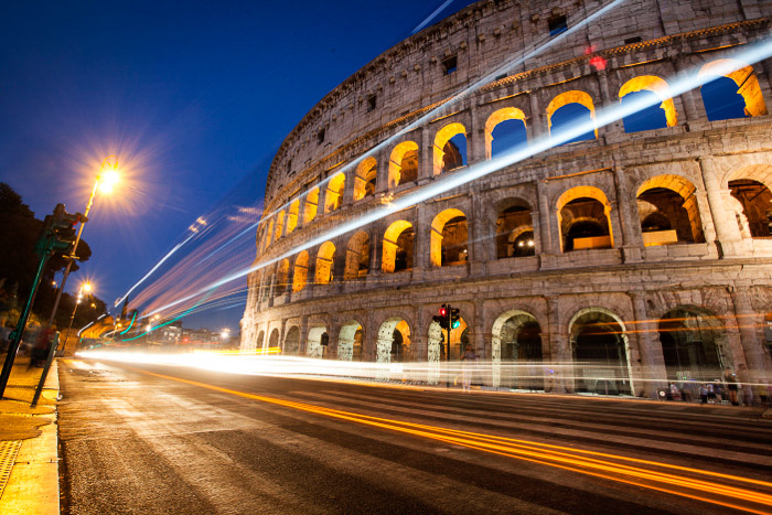 A stunning photo of car light trails outside the Colosseum at night