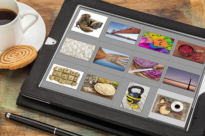 Um tablet com fotos de estoque na tela.