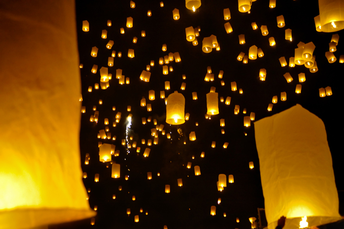 Many sky lanterns lighting at night - stock photography style