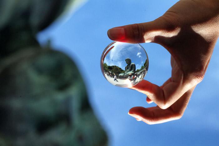 The giant Buddha in Kamakura, captured inside a lensball.