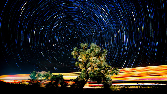A stunning time lapse shot of the night sky over a landscape, shot using a time lapse calculator