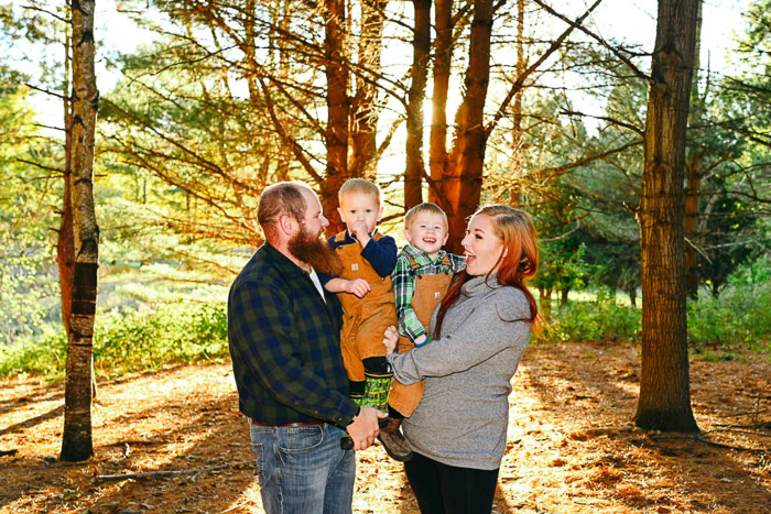 A brighta nd cheerful family porttrait in a forest - different types of portraits