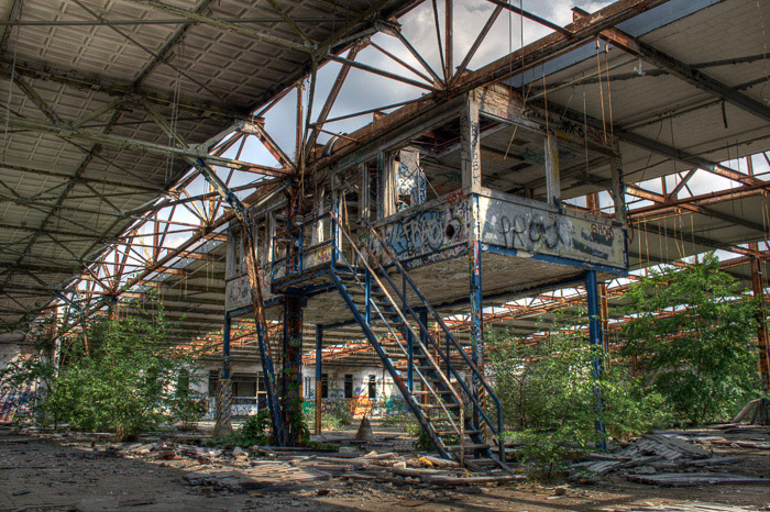 A photo of the interior of an abandoned building - urban exploration terms