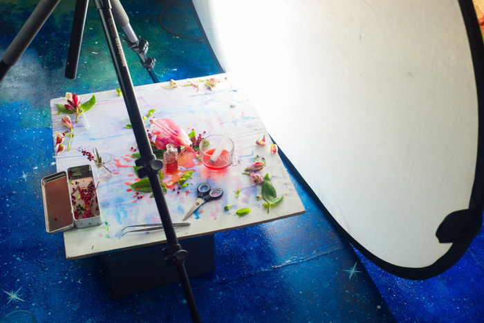 A creative still life photography setup on a hand painted background