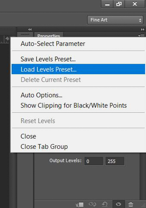 A screenshot showing how to do color correction in Photoshop with a grey card - load levels preset
