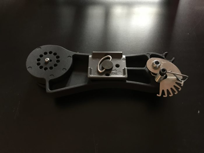 The spring loaded mechanism to balance the camera weight on the mount.