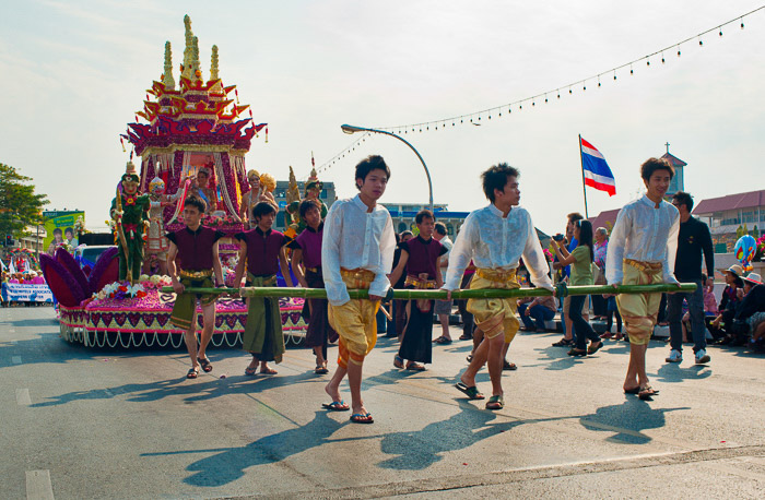 Street photo series of participants in the annual flower festival parade in Thailand