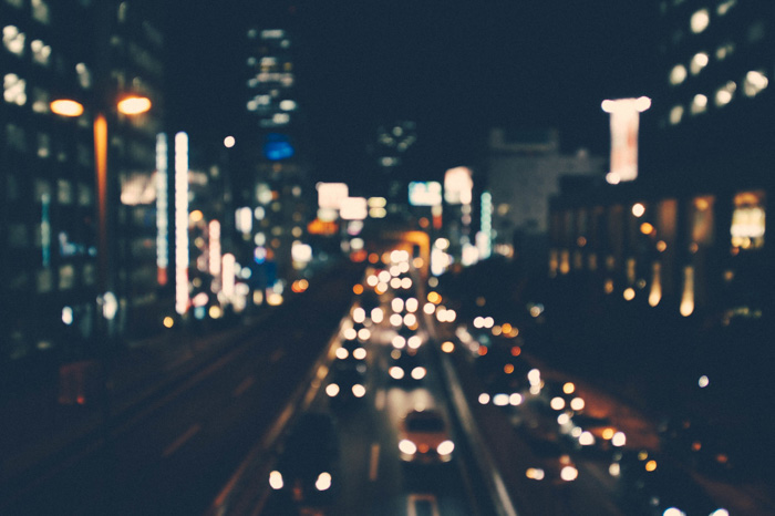 A city motorway at night, blurred due to spherical aberration