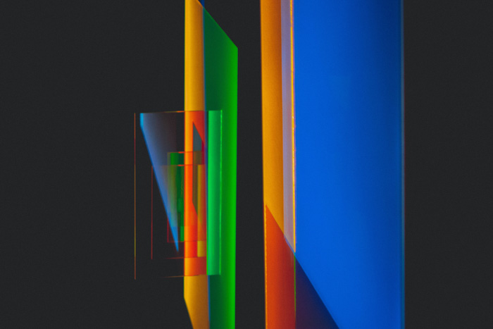 Colored geometric shapes representing aberrations in photography