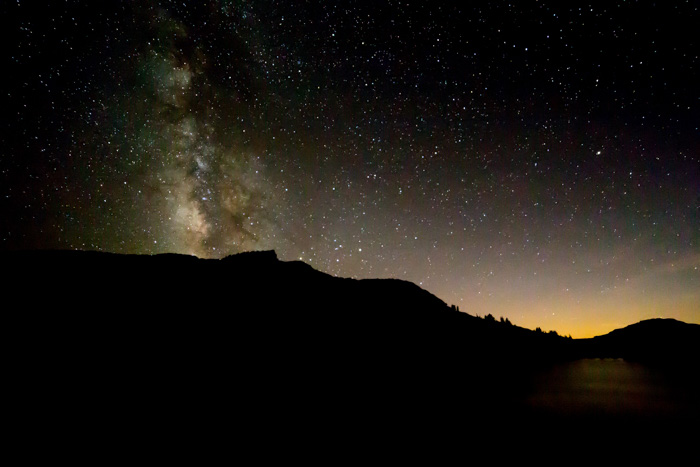 A stunning night landscape below a star filled sky at night - types of lens aberrations in photography