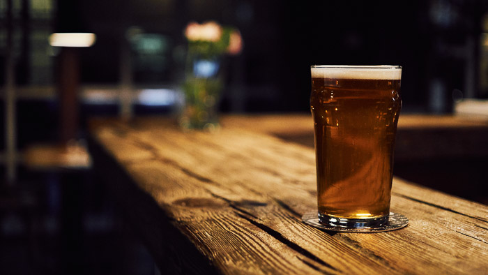A photo of beer on a bar counter - beer photography tips