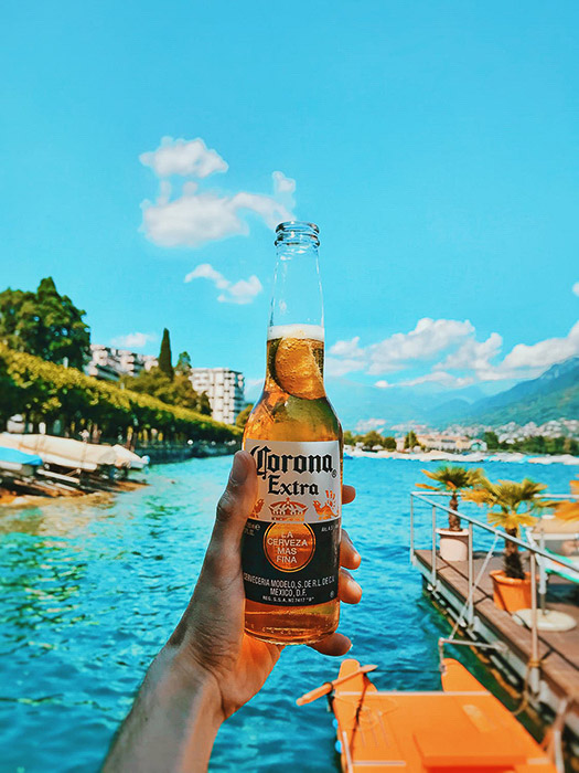 A bottle of corona beer shot against a tropical background - beer photos