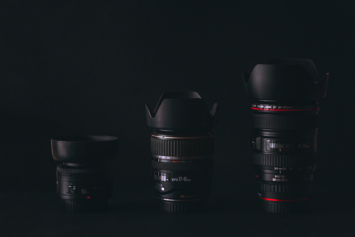 Three different types of camera lenses on a black background