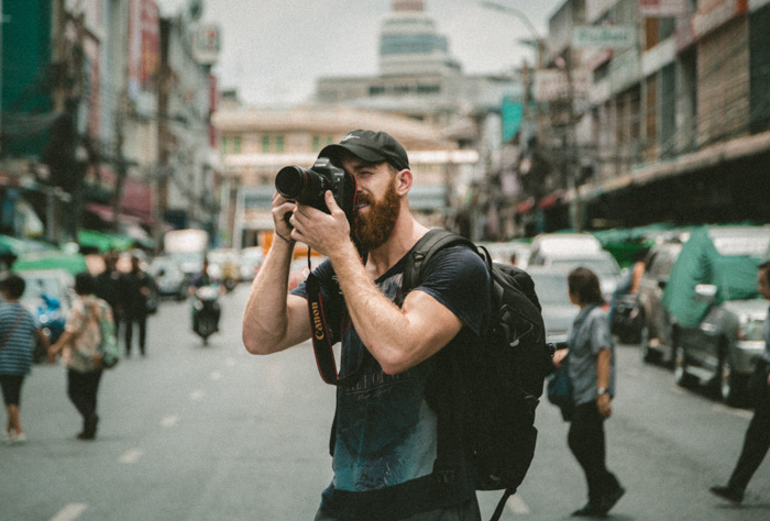 A photographer shooting with a Canon DSLR in a street - understanding the camera lens